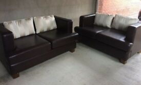 Two matching brown leather 2 seat sofas in excellent condition