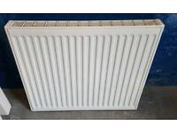 "White radiator 2ft high x 27 3/4"" with brackets"