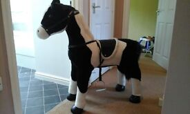 Lifelike toy horse, absolutely beautiful. Looks brand new, perfect for any horse lover!