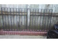 Pair of black wrought iron second hand garden gates