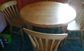 A Quality Pine Teak Colour Round Dining Table and Four Chairs