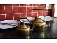 Two brass kettles £40.00