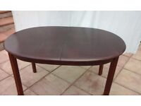 Oval extending dining table.
