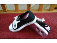 black and pink Heeleys