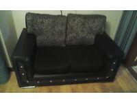 purple two 2 seater sofas