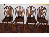 A set of 4 elm windsor wheelback chairs