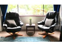 2 black recliner chairs