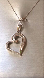 10 karat white gold heart necklace with diamond inlay