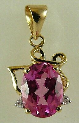 Pink Topaz 1.85ct Pendant with Diamonds 14k Yellow Gold