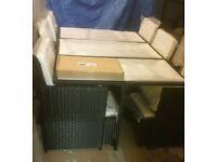 A brand new very slight seconds black 11 piece garden rattan furniture set.