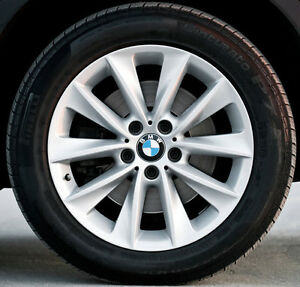 BMW X3 35i 71476 OEM mags with Nokian Hakka 8 studded tires