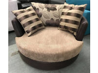 DFS lush fabric and leather cuddle chair