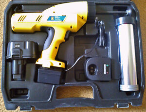 Like New POWER FIST 12V Cordless Caulking Gun w/ Charger & Case