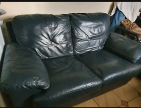 Black leather Sofa and matching foot rest