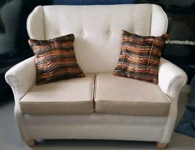 Professionally re-covered 2 seat modern sofa in cream fabric