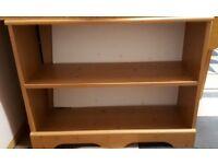 Small Immaculate Wood veneered book shelf.