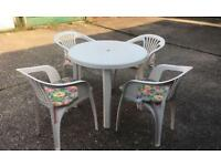Immaculate white round table and chairs with seat cushions