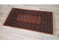 A bokhara style rug with a gold field (DELIVERY AVAILABLE)