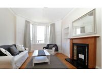 Sunny 2/3 Bedroom newly decorated and furnished Bellevue Flat