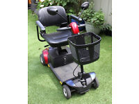 Pride Go Go Traveller LX with extra 17Ah battery, wing mirrors, cover, seat pannier, charger etc
