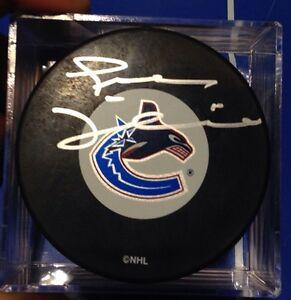 Autographed NHL hockey pucks