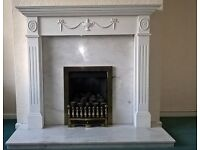 White marble hearth and back plate with white wooden (mdf) surround