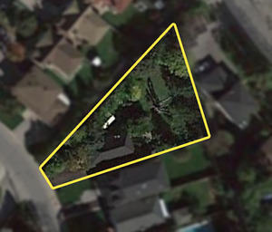 NOT ON MLS: MASSIVE PIE SHAPED BUILDING LOT IN THE BLUFFS!!