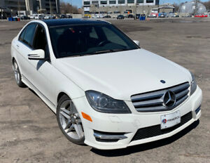 Superbe Mercedes Benz C300 4MATIC blanche - 2012 - AMG Package
