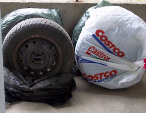4 Michelin winter radial tires with rims for sale.