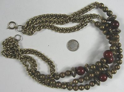 1950s Jewelry Styles and History Vintage 1950's 3 Strand Brass Beads Necklace $15.00 AT vintagedancer.com