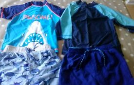 Two sets of boys swimwear 5-6 with rash vests