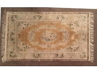 Beige /light floral patterned rug