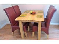 Solid Oak Dining Table from the Chaucer Solid Oak Range and 4 chairs.
