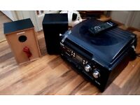 Compact nostalgia style music system with radio, CD & cassette and speakers.