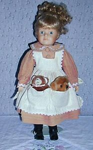Porcelain Doll with 2 Bears in pocket .. Excellent Condition ..