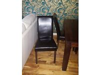 Lovely wooden Dining table and 4 matching leather chairs