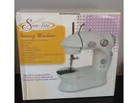Mini electric sewing machine as new, still boxed