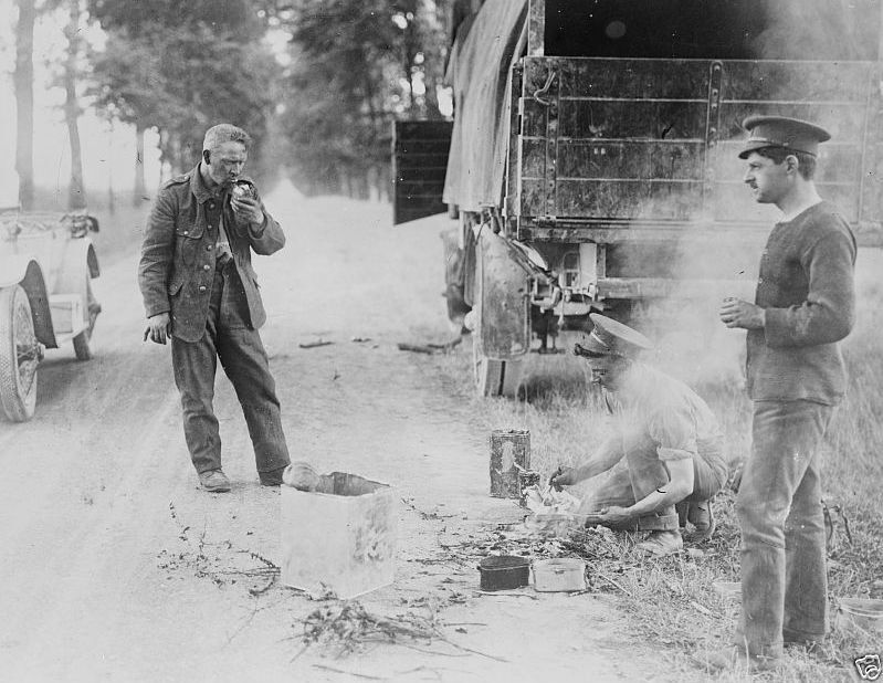 British troops cooking beside a transport truck in France World War I 8x10 Photo