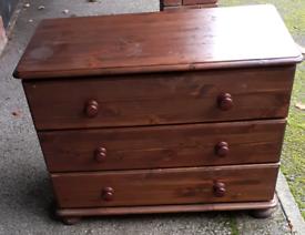 Dark wooden chest of draws