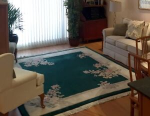 Beautiful Dark Green Persian Rug with Pale Pink Flowers
