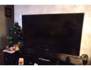SAMSUNG 6Series LN46B610 LCD TV with stand and APPLE TV unit