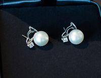 Pearl and Diamond Earclips, Birks Blue $2,500.00