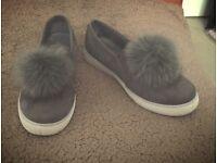 Grey pom-pom shoes