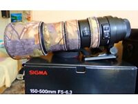 great condition sigma 150--500mm telephoto lens with camo sleeve ; boxed complete.