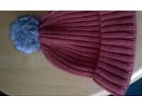 ladies hat new but no labels rusty colour with grey fluffy pompom