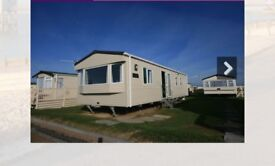 2 bed.6 berth.gas central heating,double glazed.1 year old.price includes all bedding,tv,microwave.