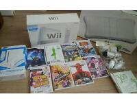 Nintendo Wii complete console with Wii Fit board games and microphones