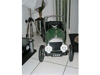 Vintage child's car in Green pedals