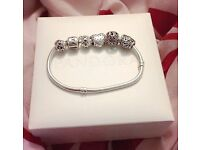 Pandora charm bracelet, 5 charms included only worn a handful of times