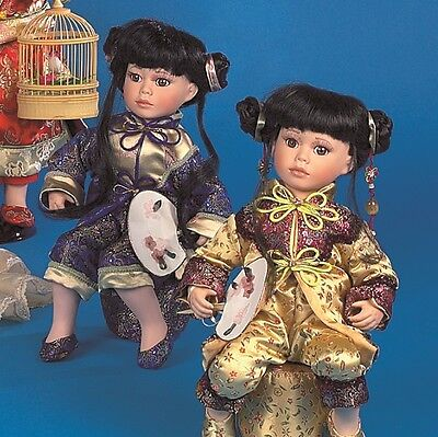 """A Job Lot of 9 Vanity Fair Sitting 16"""" Chinese Dolls (3 assorted colours)"""